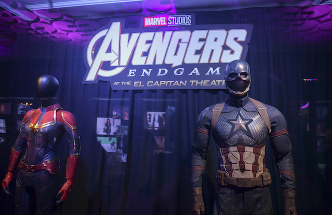 Captain Marvel's and Captain America's suits on display.