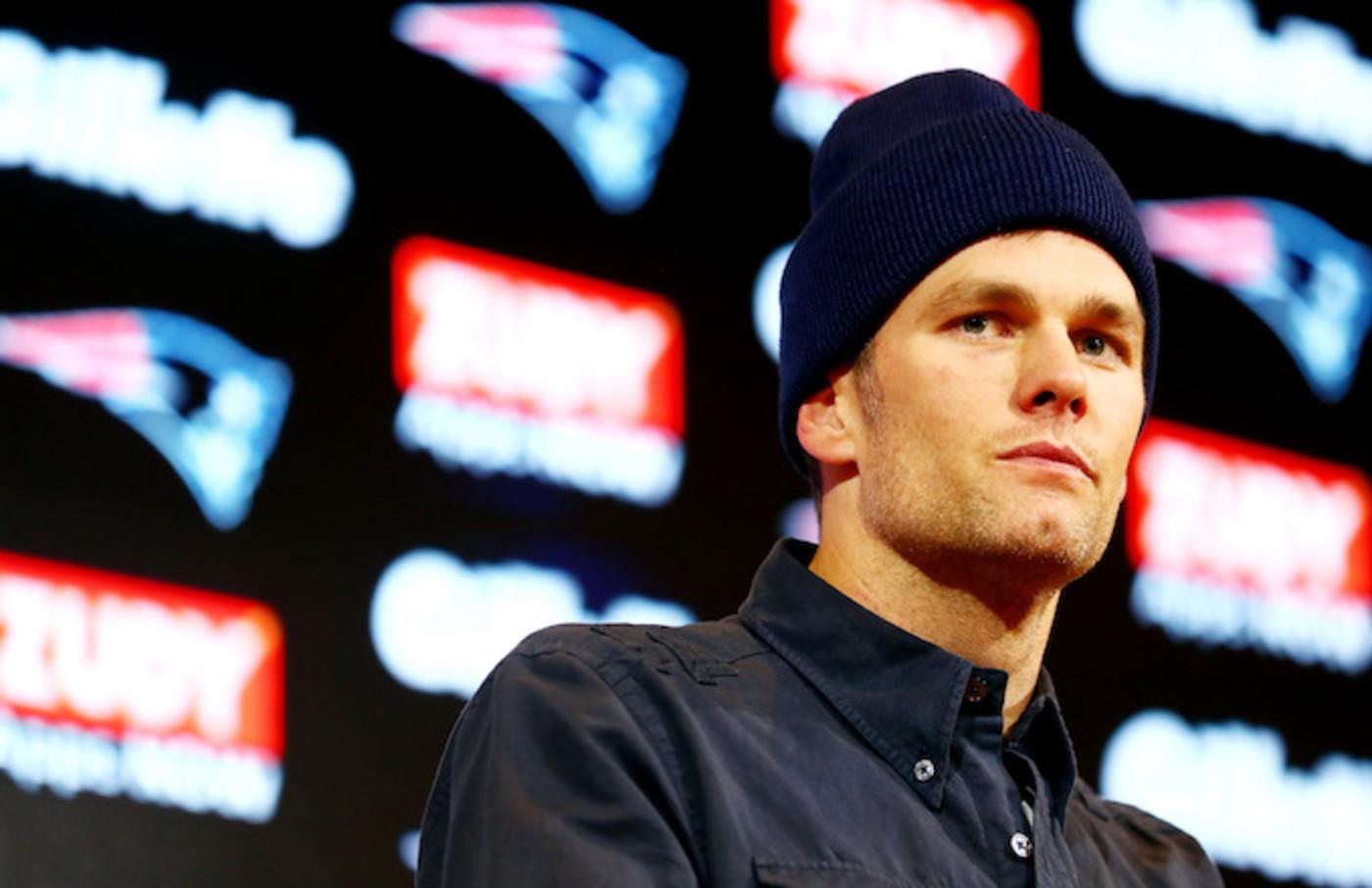 Tom Brady #12 of the New England Patriots speaks with the media.