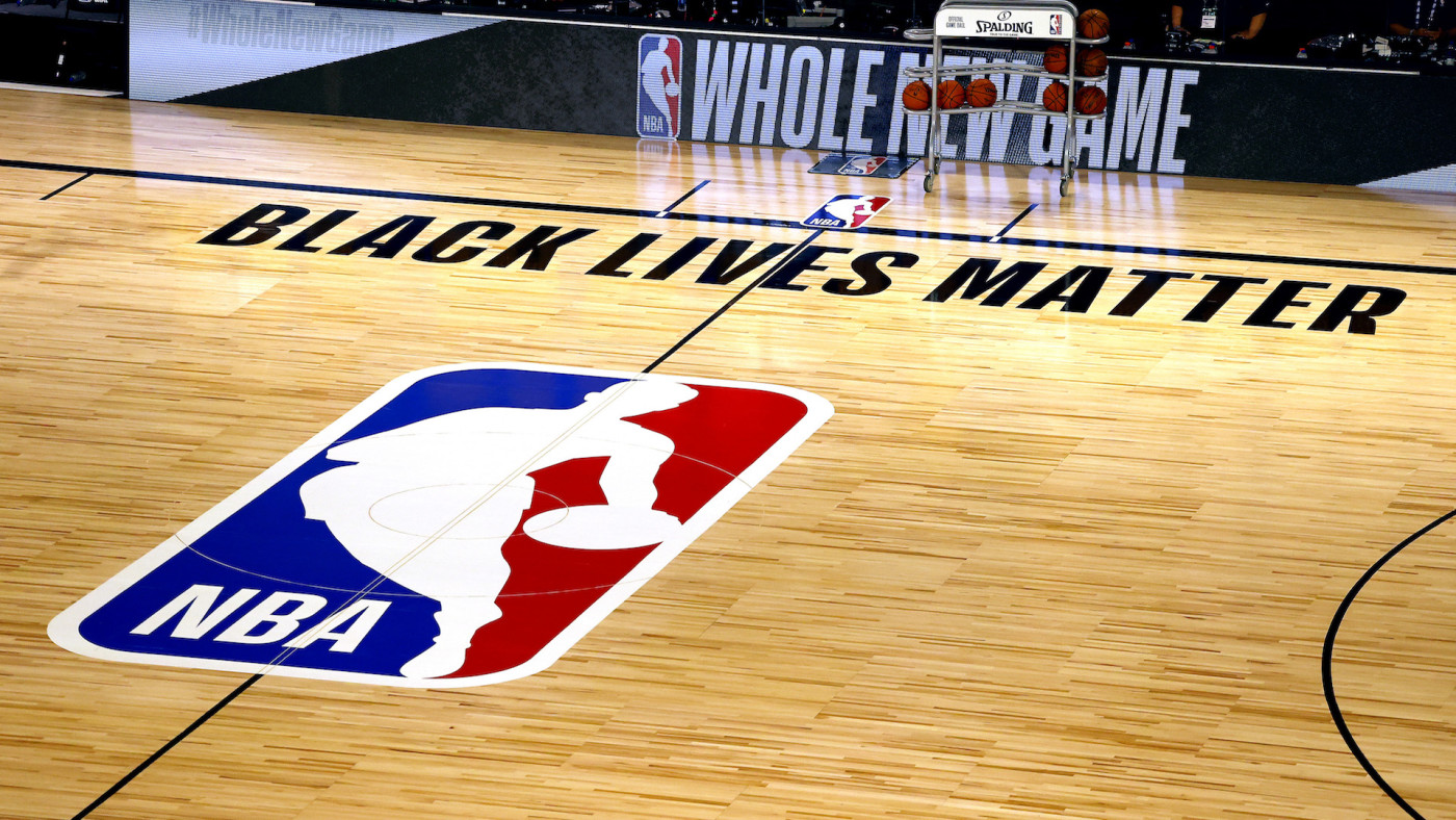 An overview of the basketball court shows the NBA logo and Black Lives Matter.