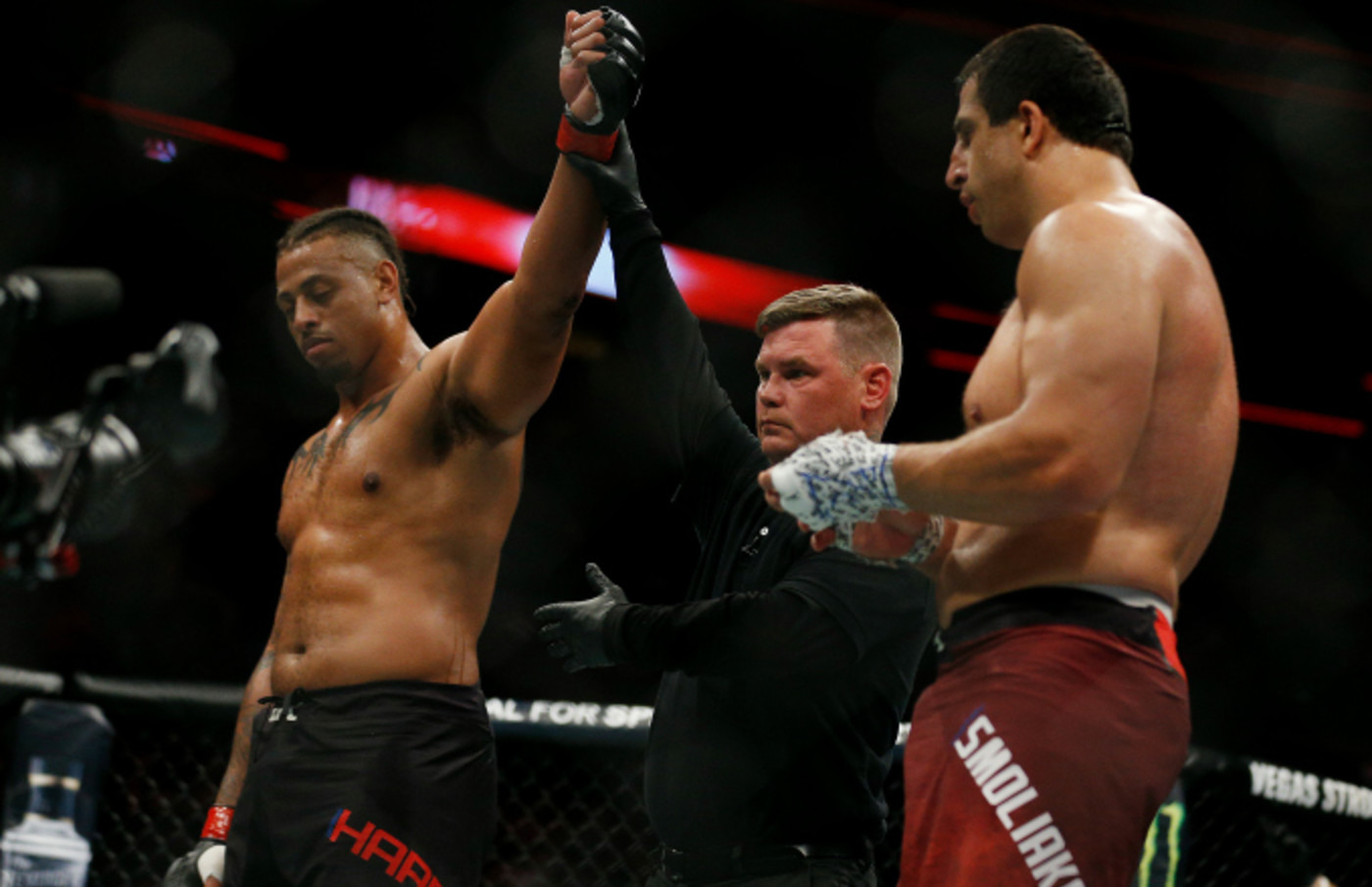 Greg Hardy reacts after defeating Dmitrii Smoliakov