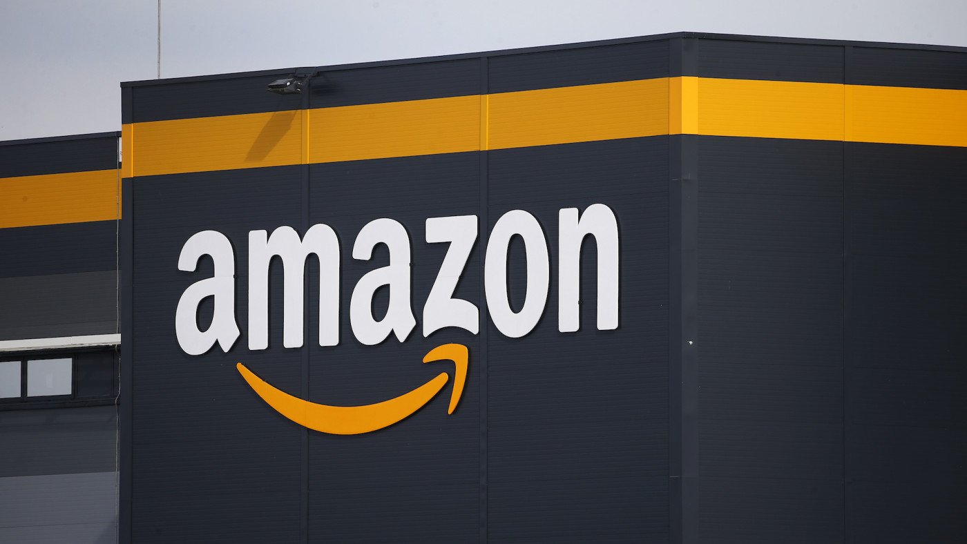 The logo of Amazon is seen on the facade of the company logistics center.