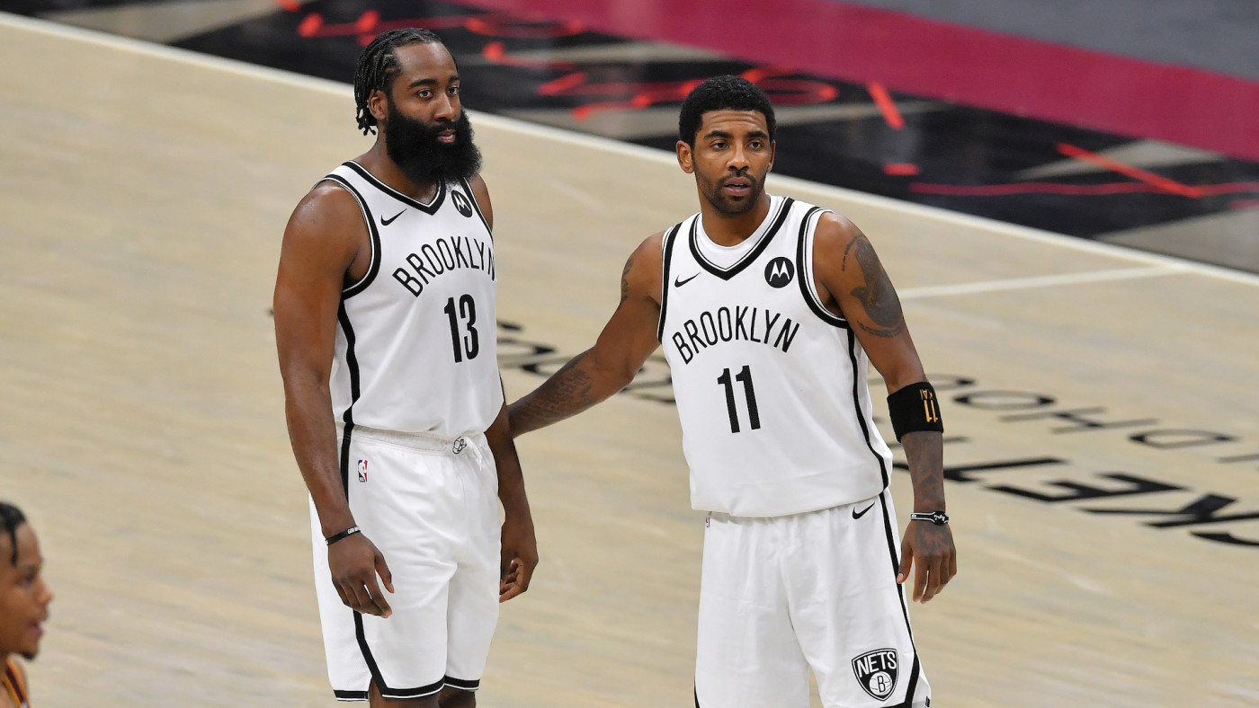 James Harden #13 talks with Kyrie Irving #11 of the Brooklyn Nets