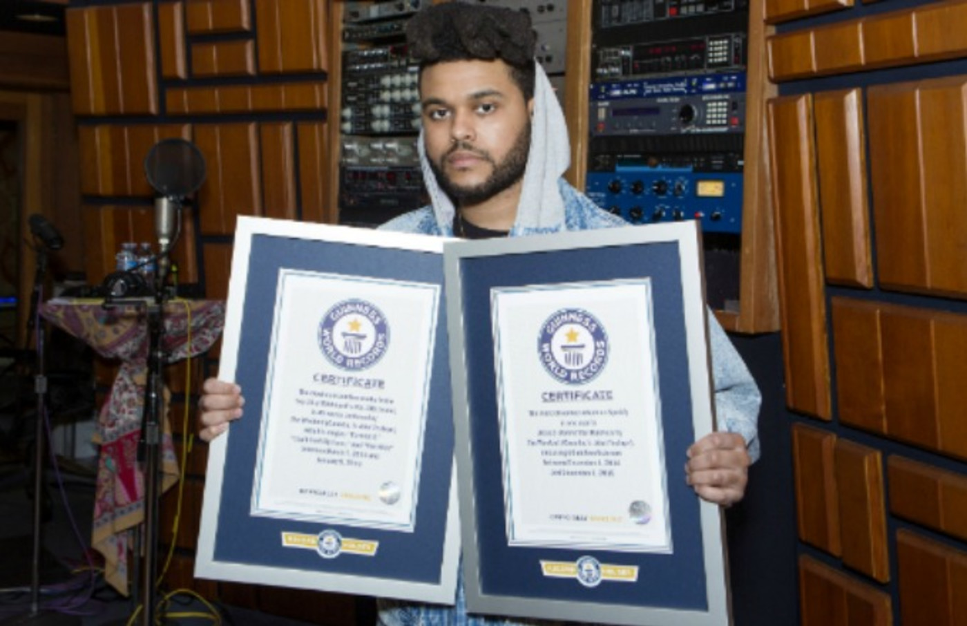 This is the Weeknd with His Guiness World Record certificates.