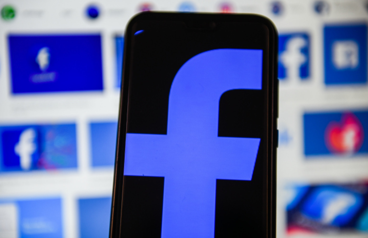 In this photo illustration a Facebook logo displayed on a smartphone