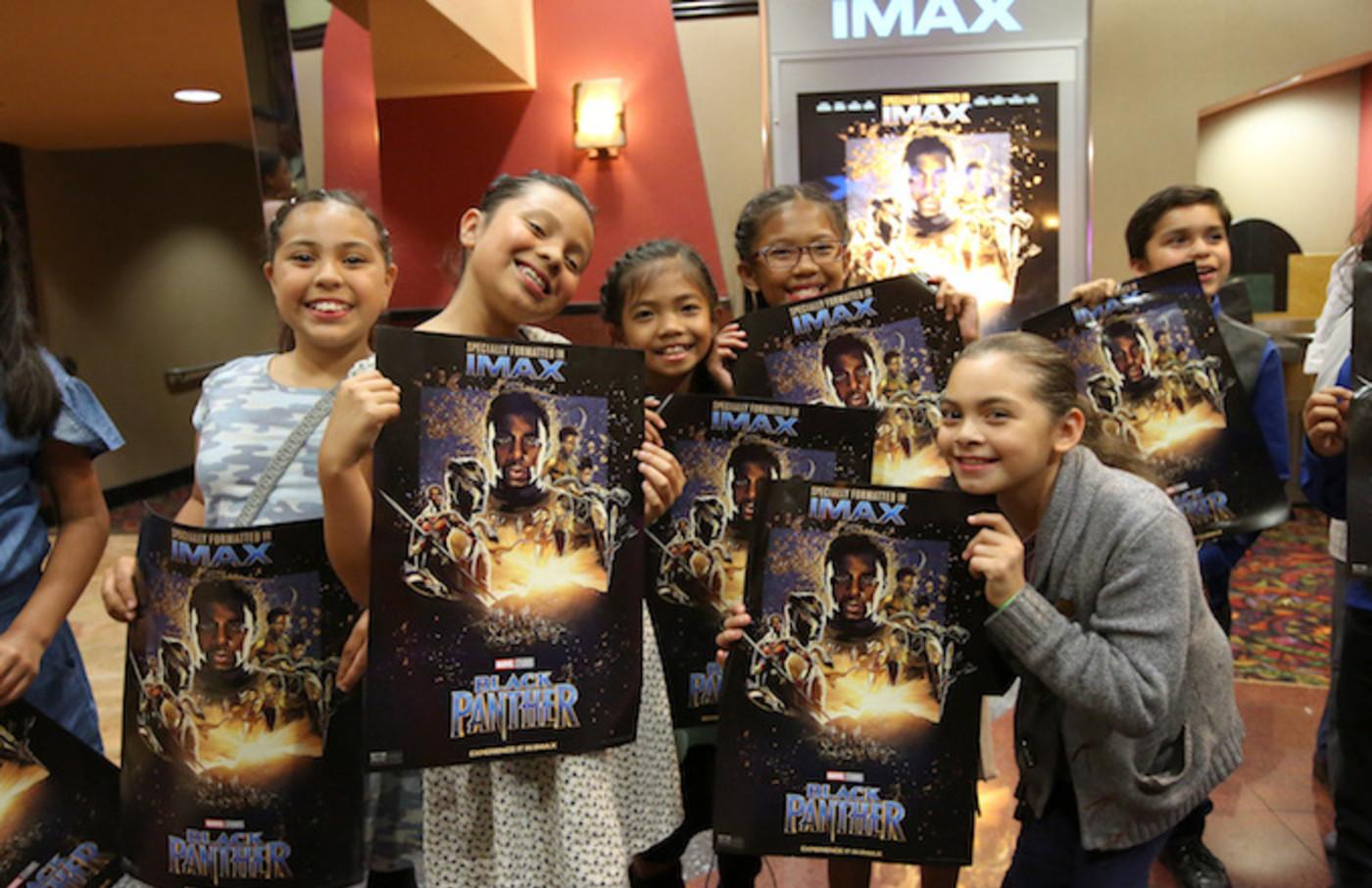 Boys & Girls Club Long Beach members watching Black Panther.