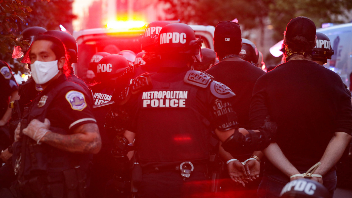 Protesters are taken after being arrested by Washington D.C. Metropolitan Police officers.
