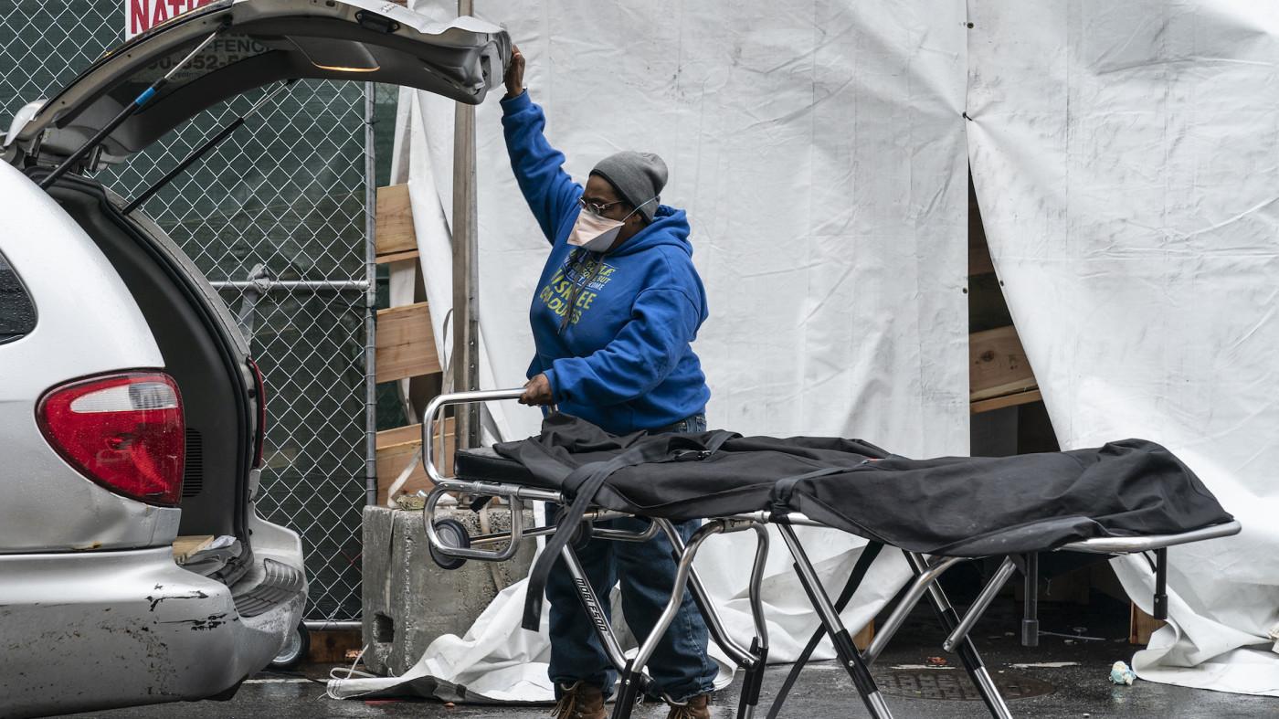 Funeral worker prepares for retrieving deceased body