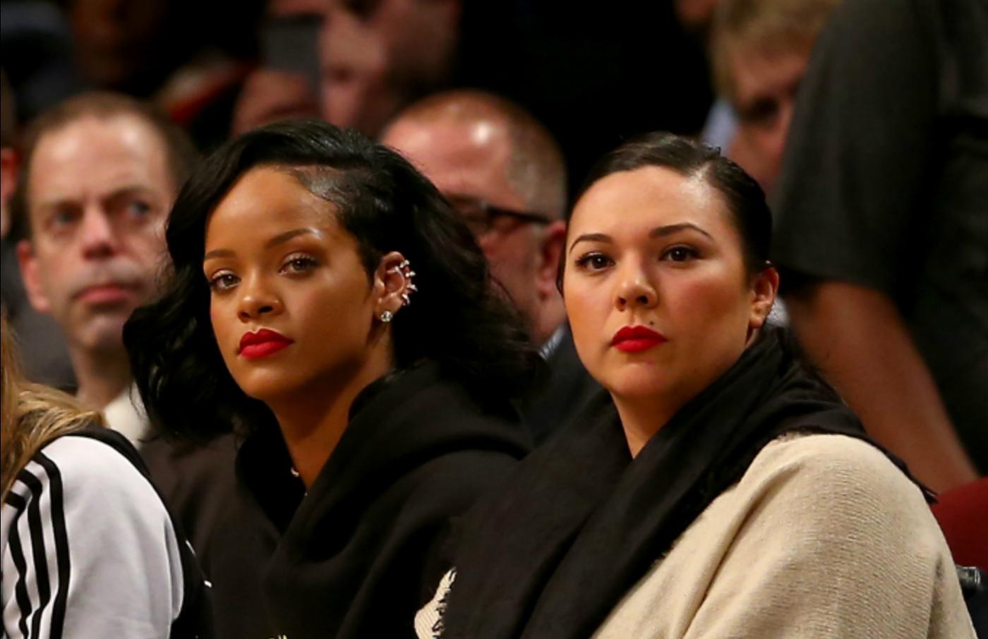 Rihanna and Jennifer Rosales attend NBA game