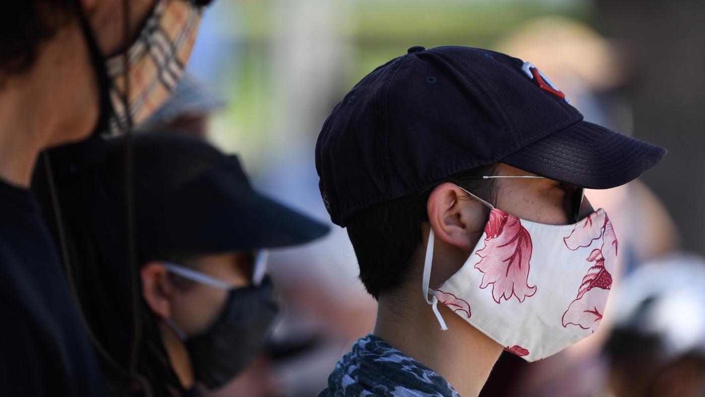 People wear facemasks