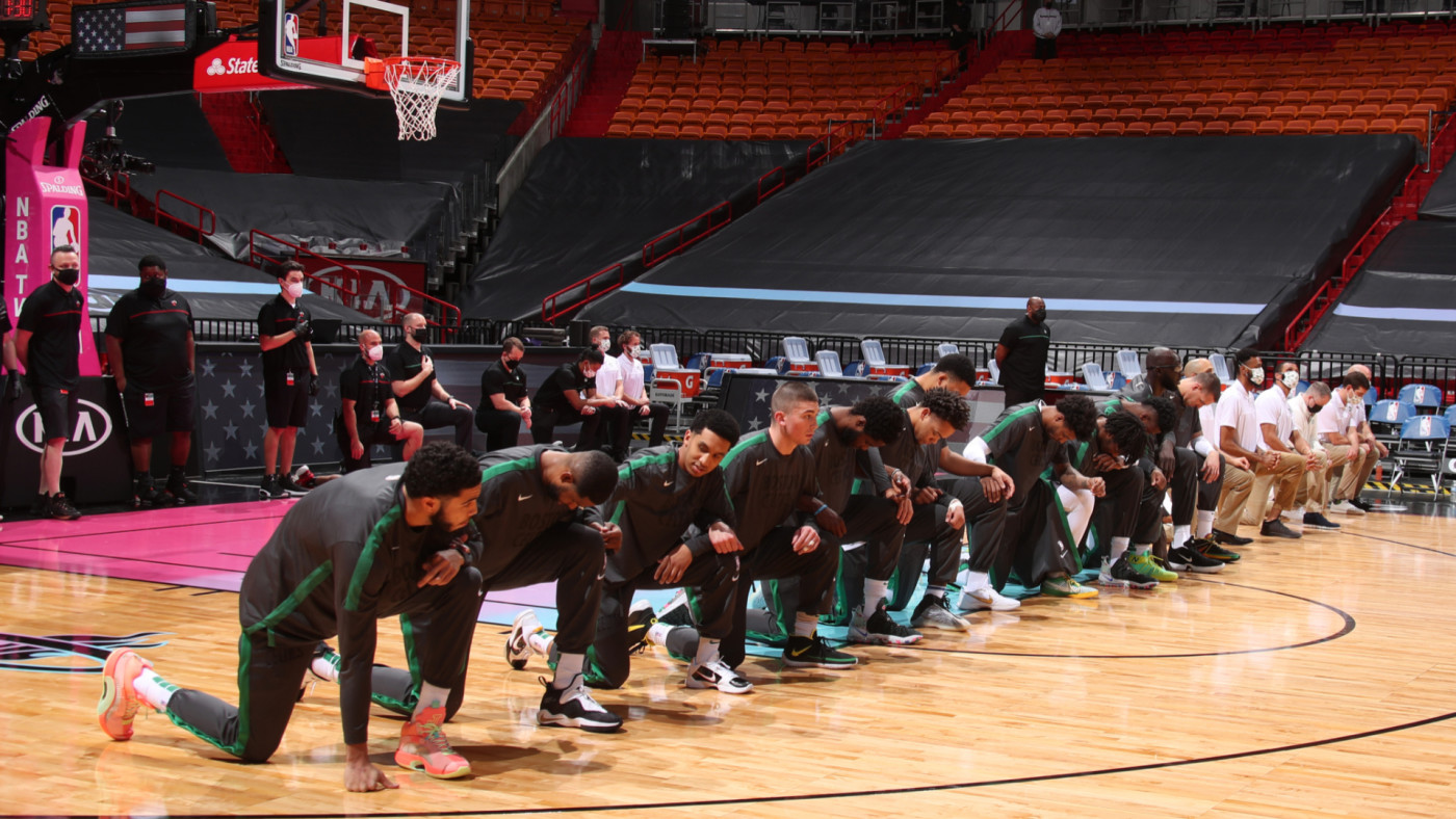 Celtics players look on during the national anthem before the game against the Heat.