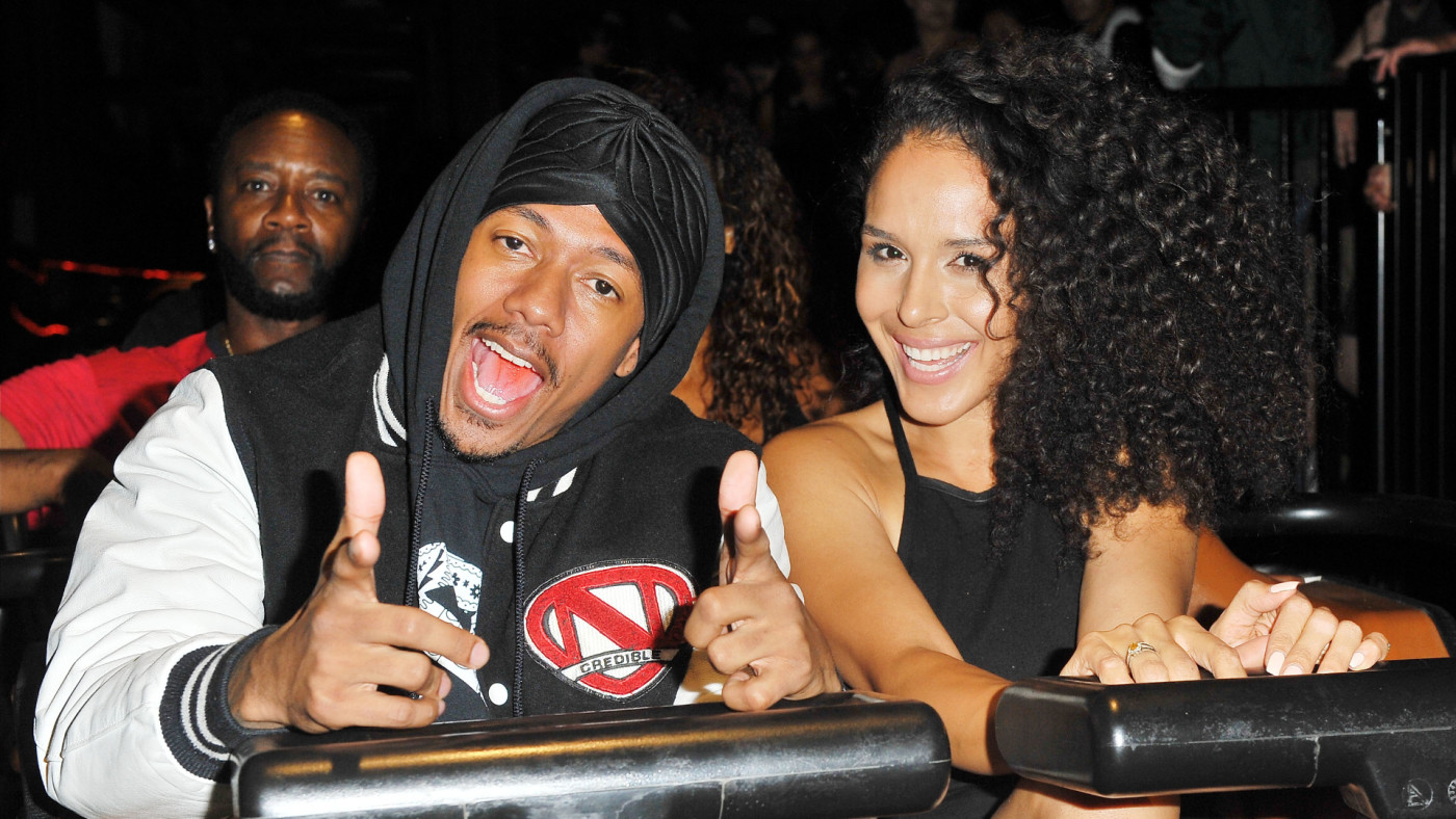 Nick Cannon and Brittany Bell ride the 'Ghostrider' Roller Coaster.