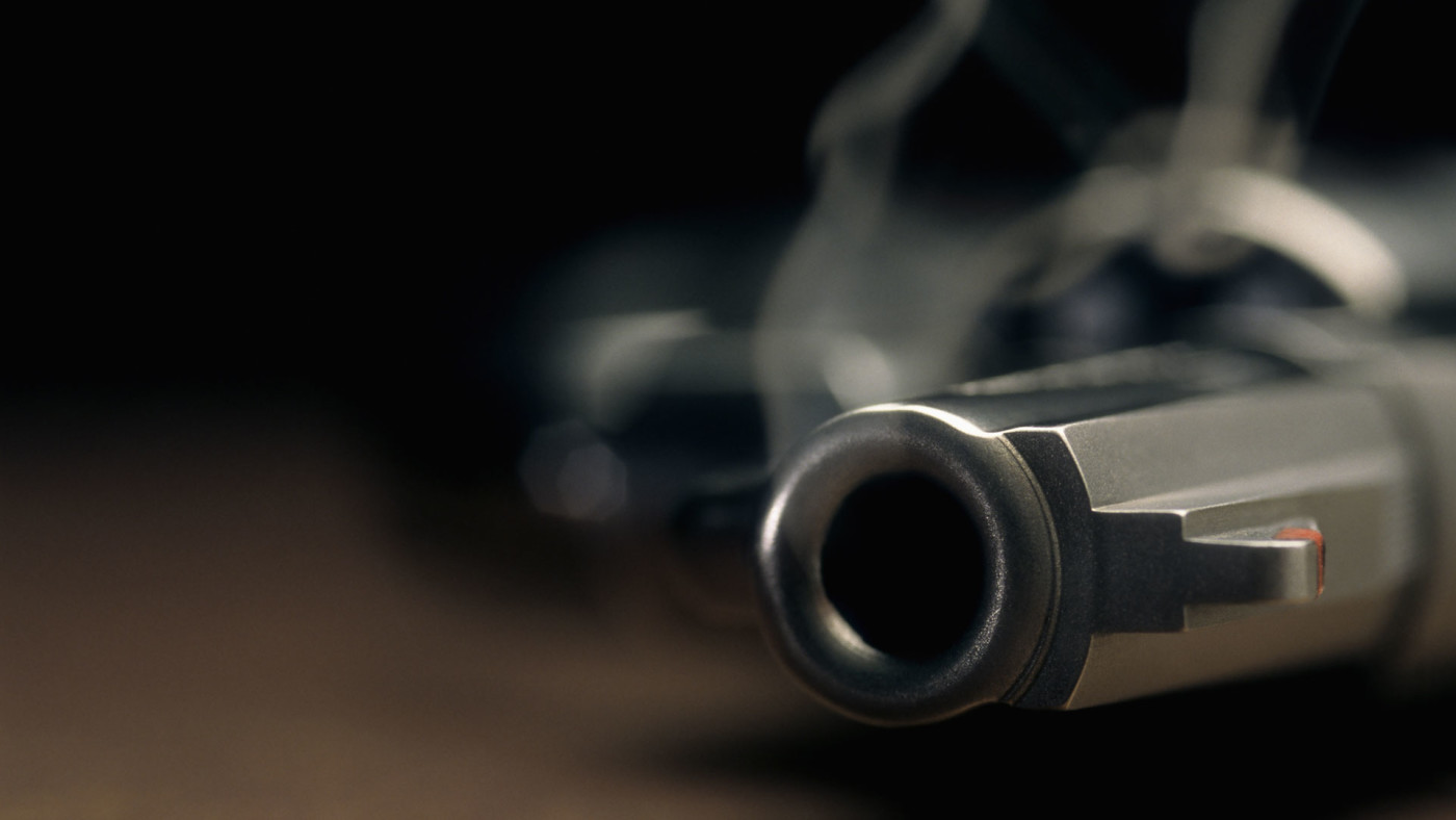A just fired gun resting on the floor.