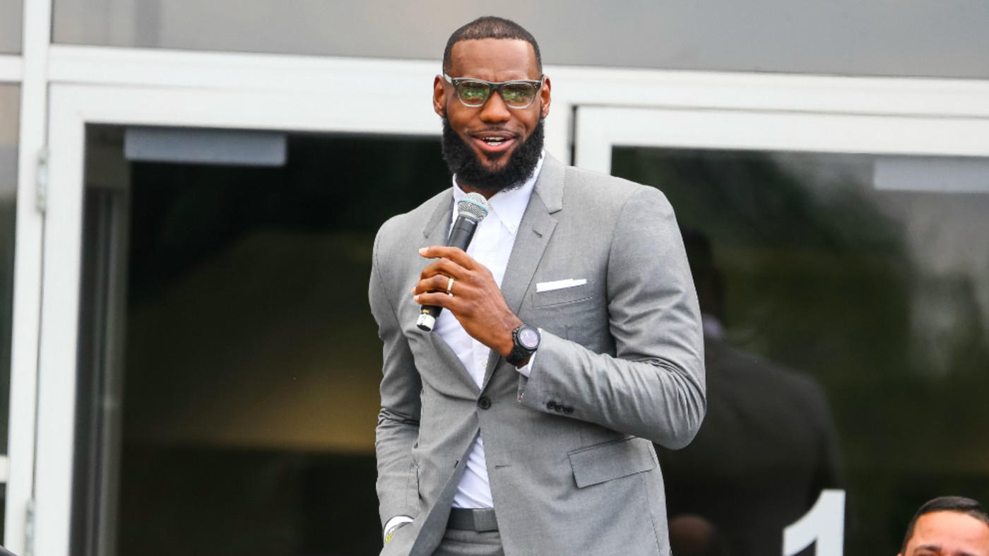 LeBron James addresses a crowd at the grand opening of the I Promise school