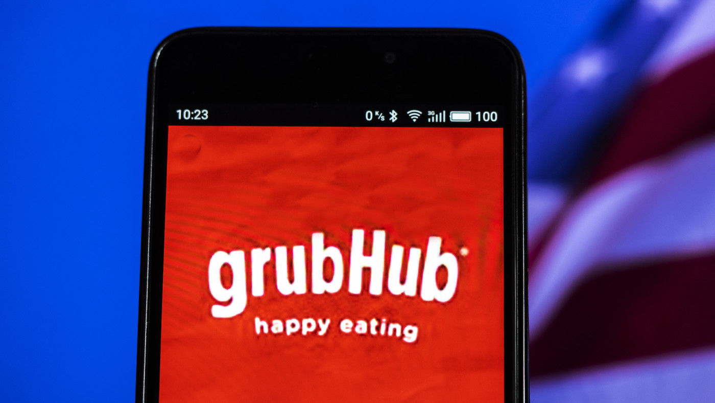 In this photo illustration, the GrubHub logo seen displayed on a smartphone.