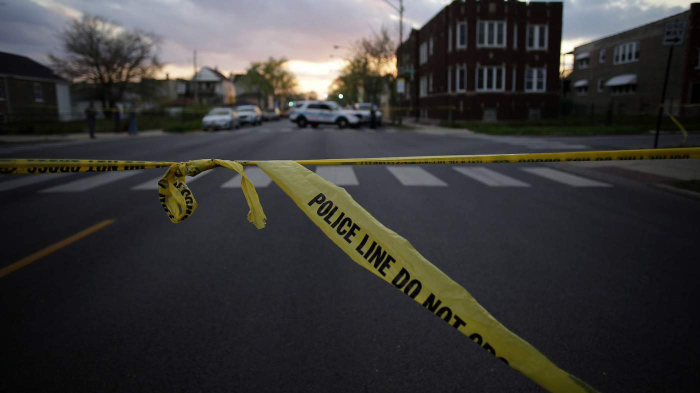 Chicago Police crime tape is displayed at the scene
