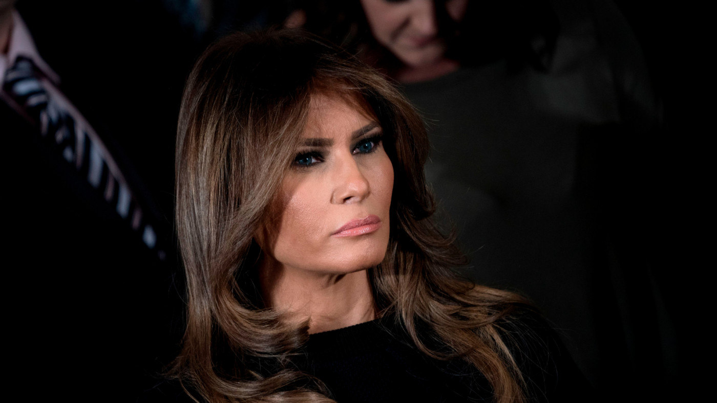 Melania Trump listens to the US president deliver remarks.