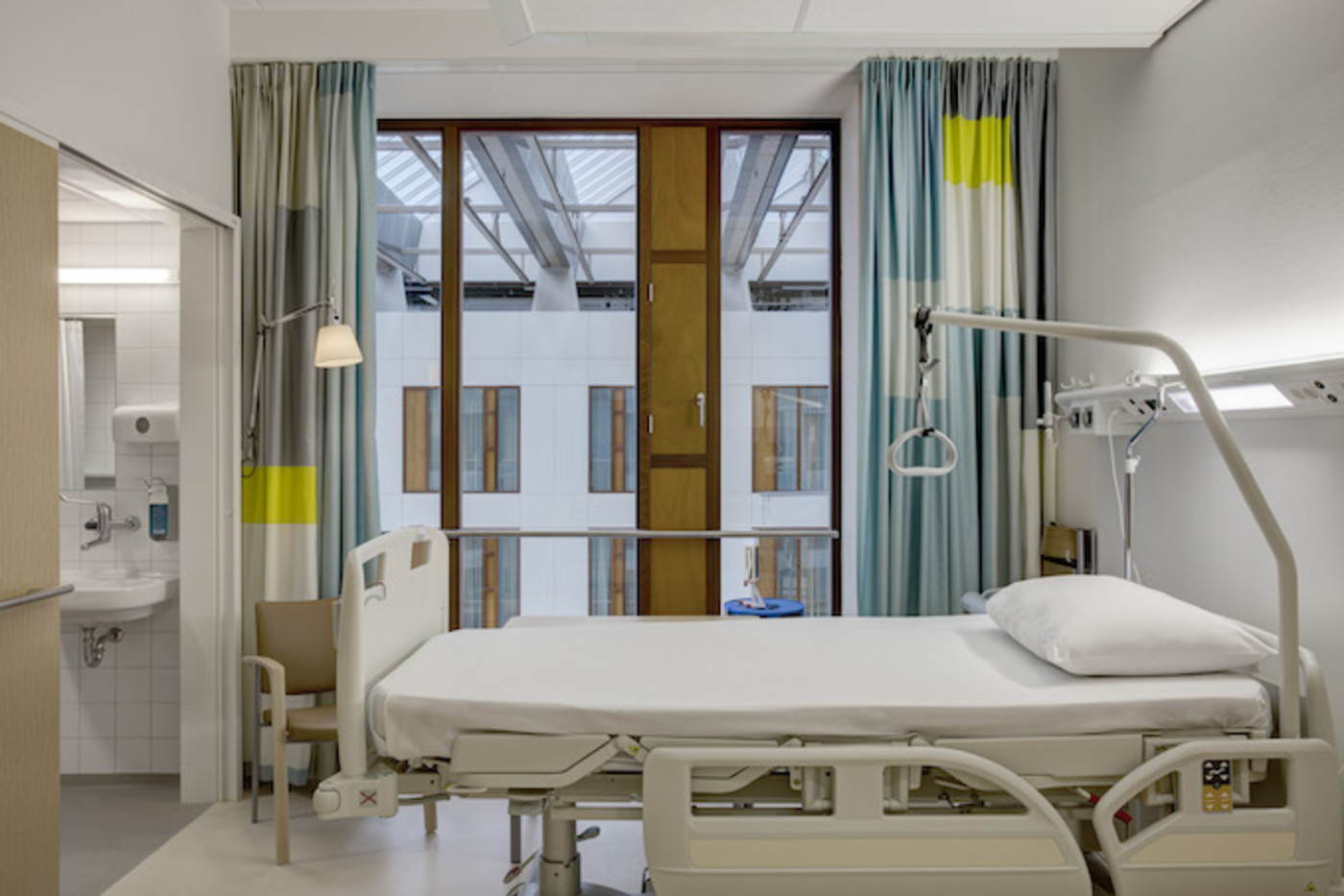 Bed in hospital room