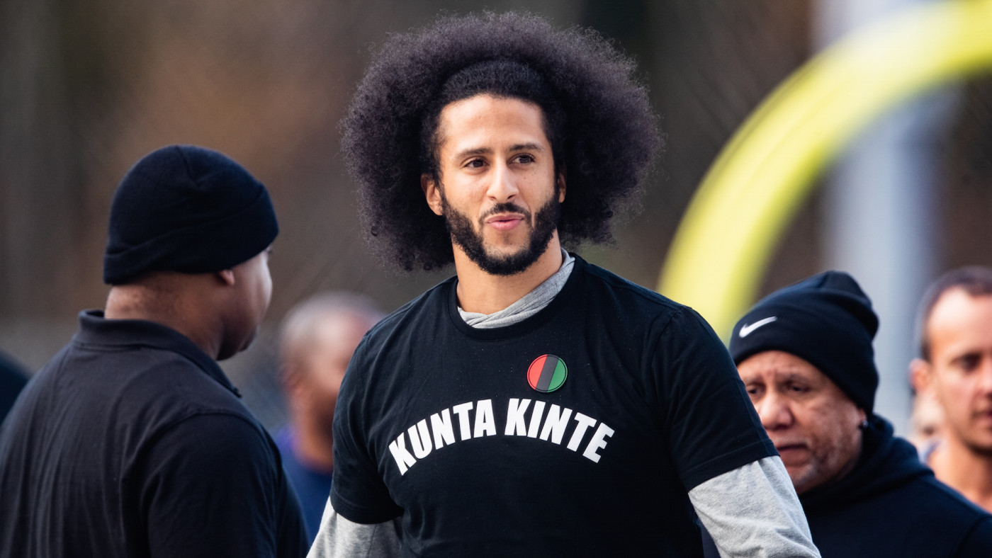 Colin Kaepernick looks on during his NFL workout held at Charles R Drew high school