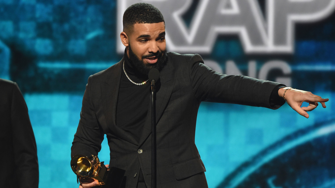 "Drake accepting a Grammy Award for ""Best Rap Song."""