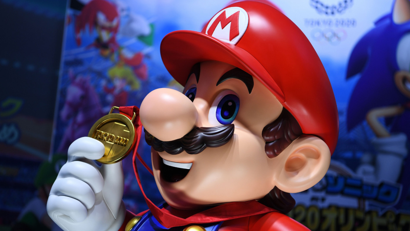 """Mario is seen at a promotional booth for """"Mario & Sonic at the Olympic Games Tokyo 2020."""""""