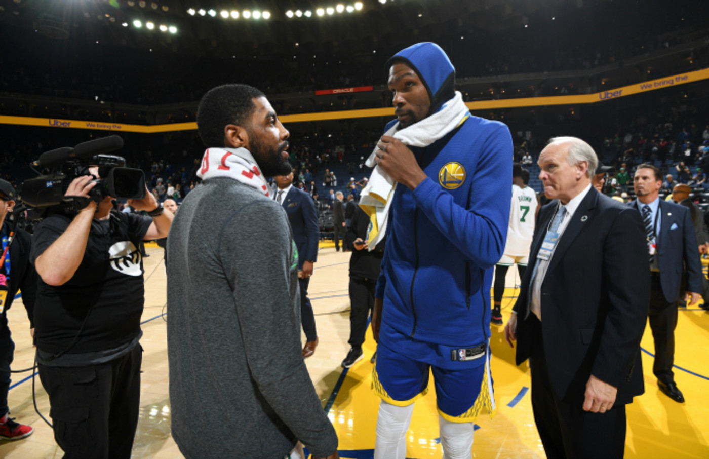Kyrie Irving #11 of the Boston Celtics speaks with Kevin Durant #35 of the Golden State Warriors