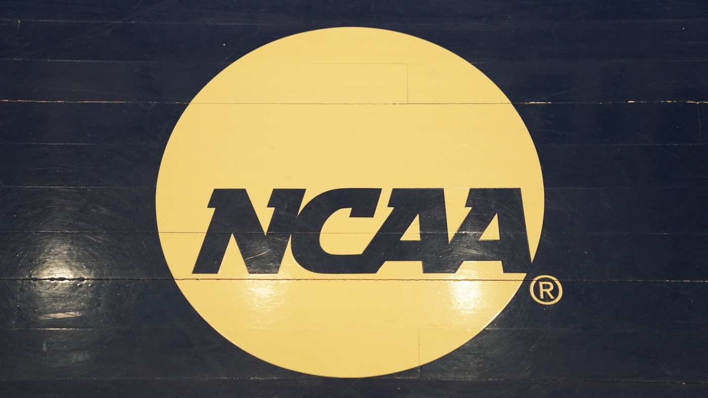 The NCAA logo on the floor during a Atlantic 10 Women's Basketball Tournament.