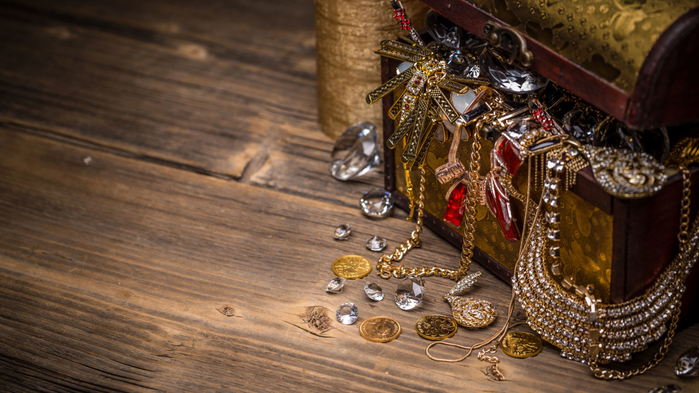 Treasure chest on wooden background.