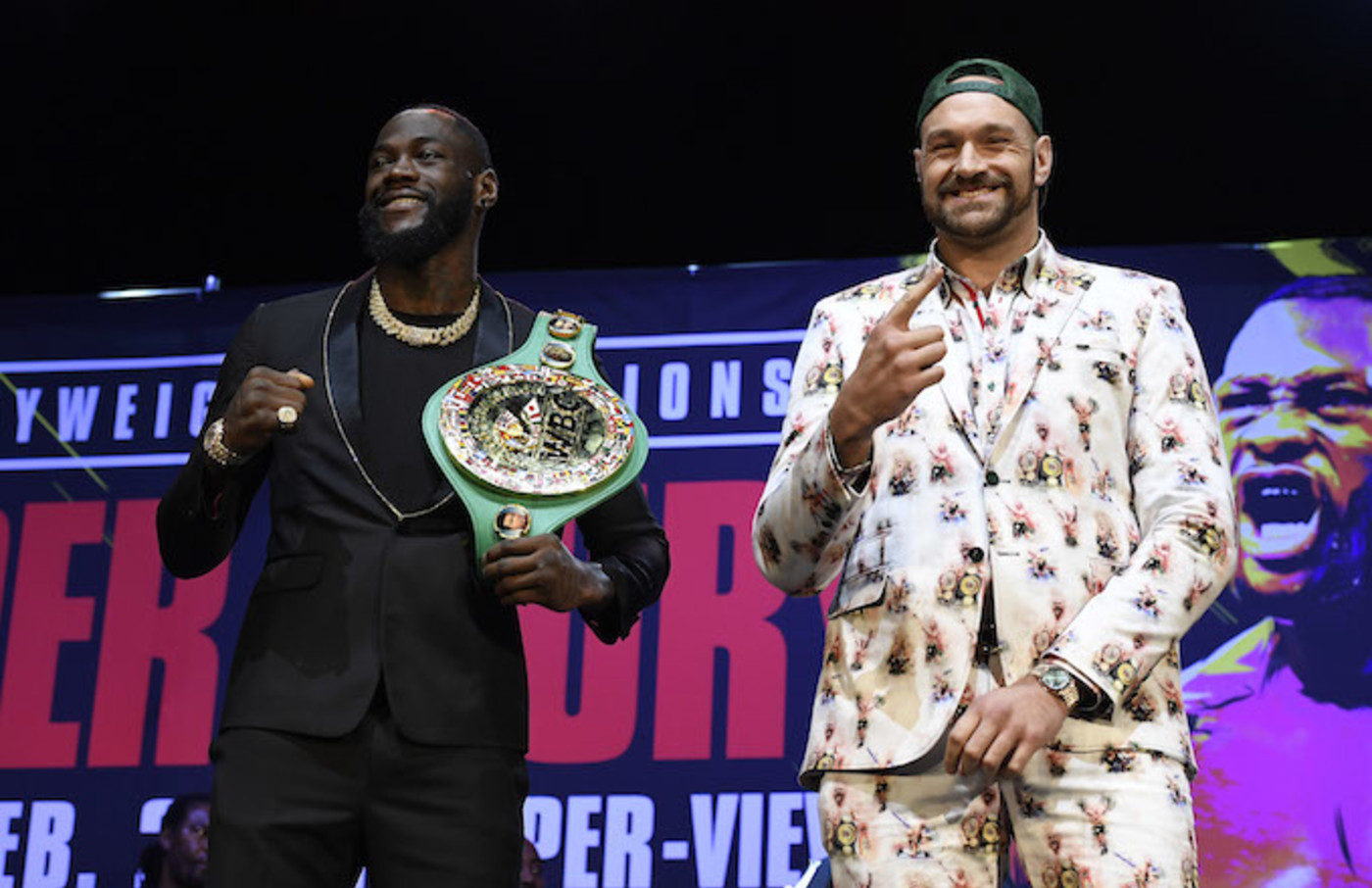 Deontay Wilder and Tyson Fury get together during a news conference at The Novo Theater.