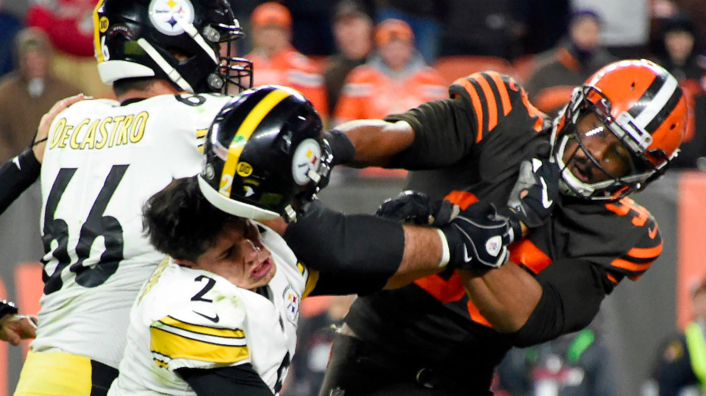 Defensive end Myles Garrett of the Cleveland Browns hits Quarterback Mason Rudolph