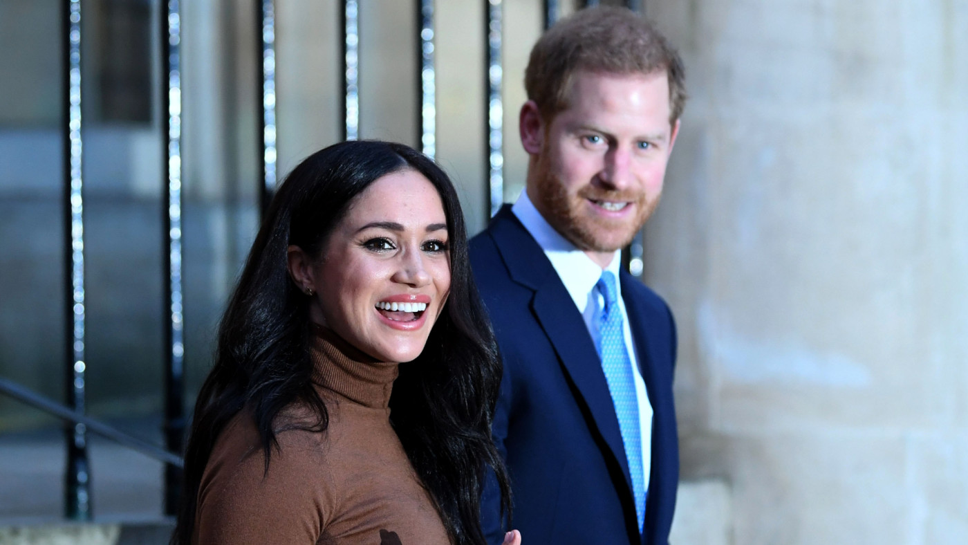 Prince Harry and Meghan Markle react after their visit to Canada House.