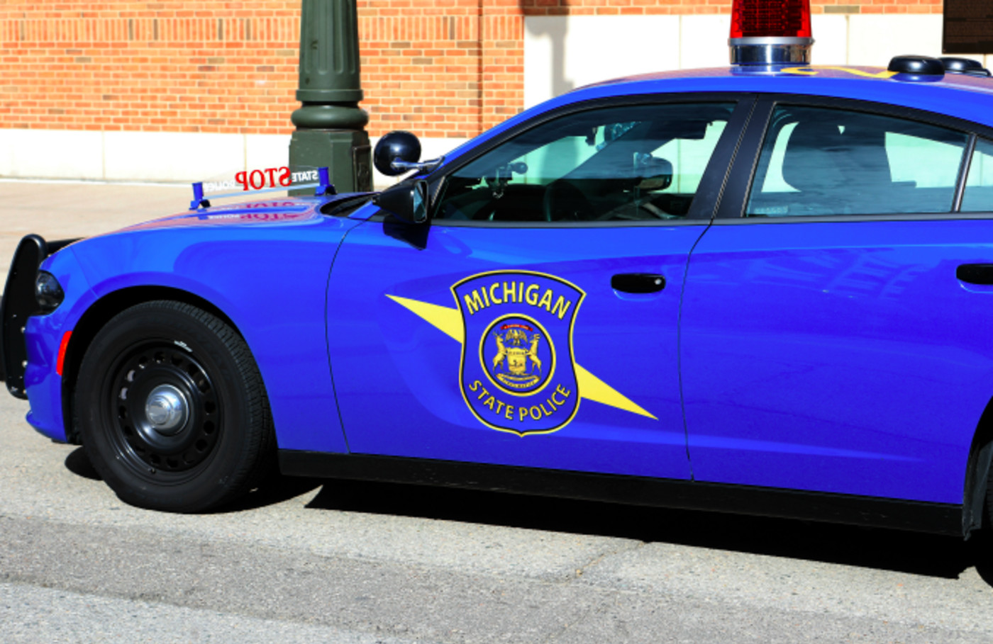 Michigan State Police vehicle sits parked outside Comerica Park in Detroit