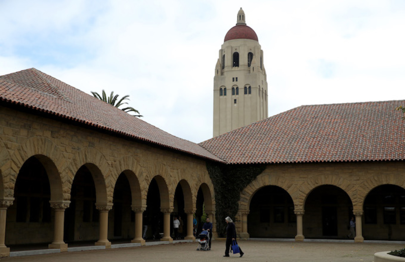 People walk by Hoover Tower on the Stanford University campus.
