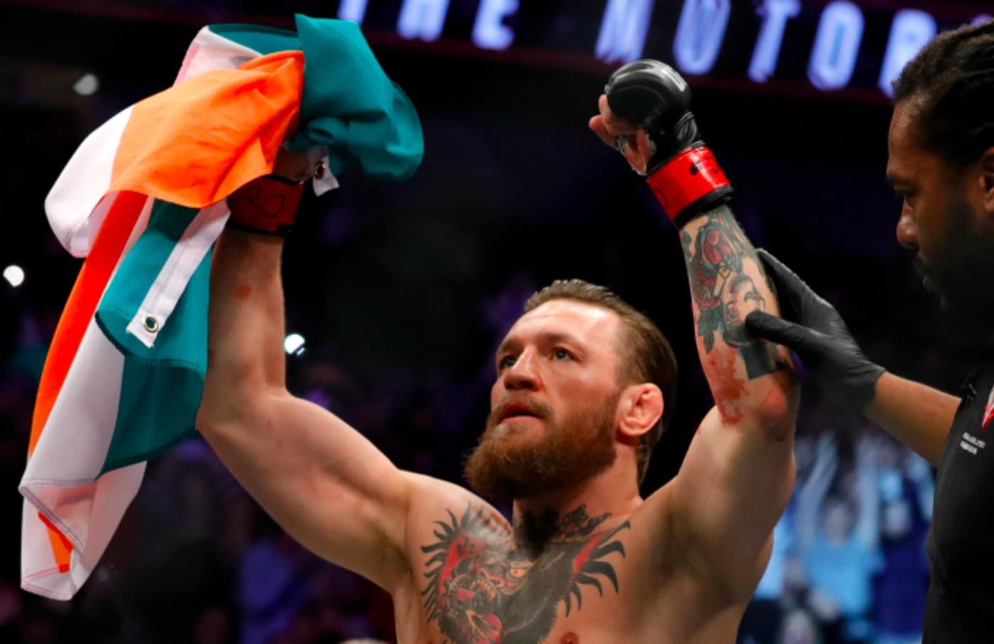 Conor McGregor celebrates after defeating Donald Cerrone