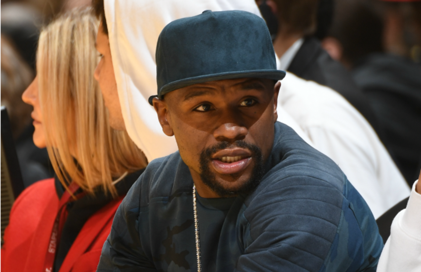 Professional boxer Floyd Mayweather attends a game