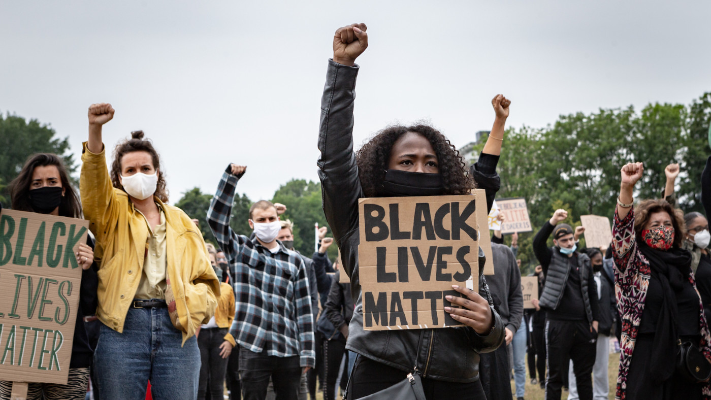 Protesters take part in a demonstration against police brutality and racism.