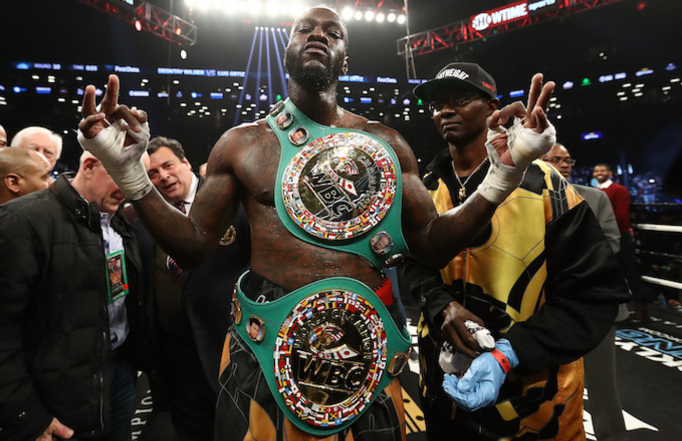 Deontay Wilder poses after knocking out Luis Ortiz.