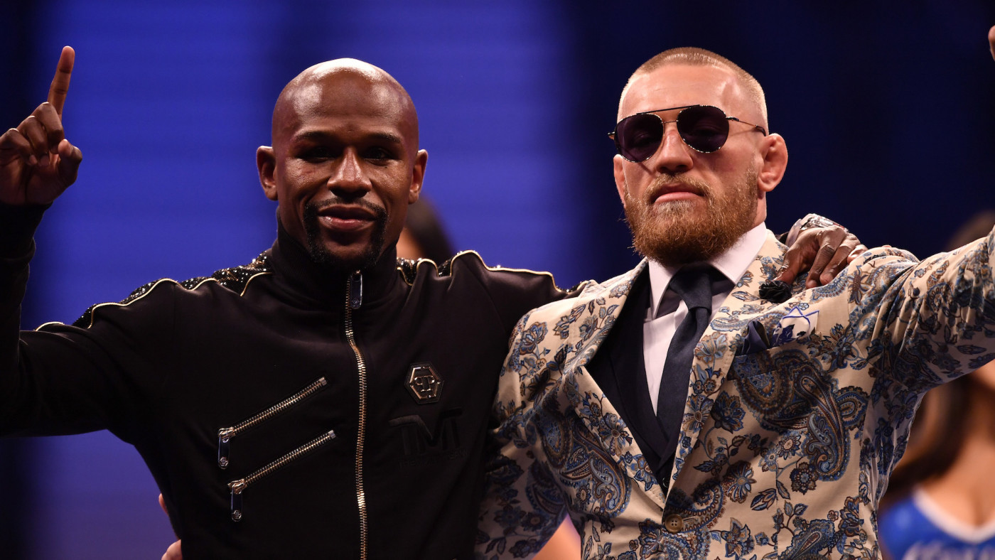 Floyd Mayweather Jr. and Conor McGregor pose for pictures
