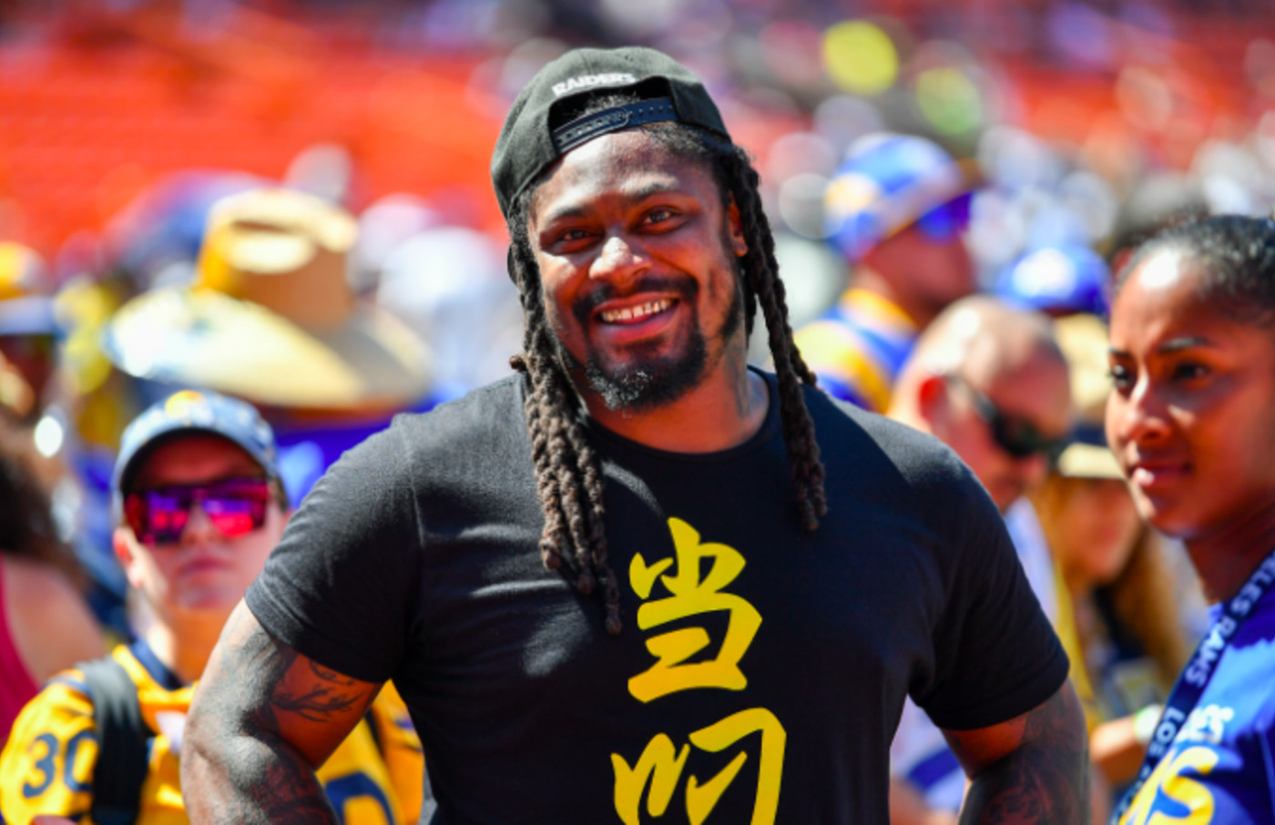 Retired NFL footballer Marshawn Lynch