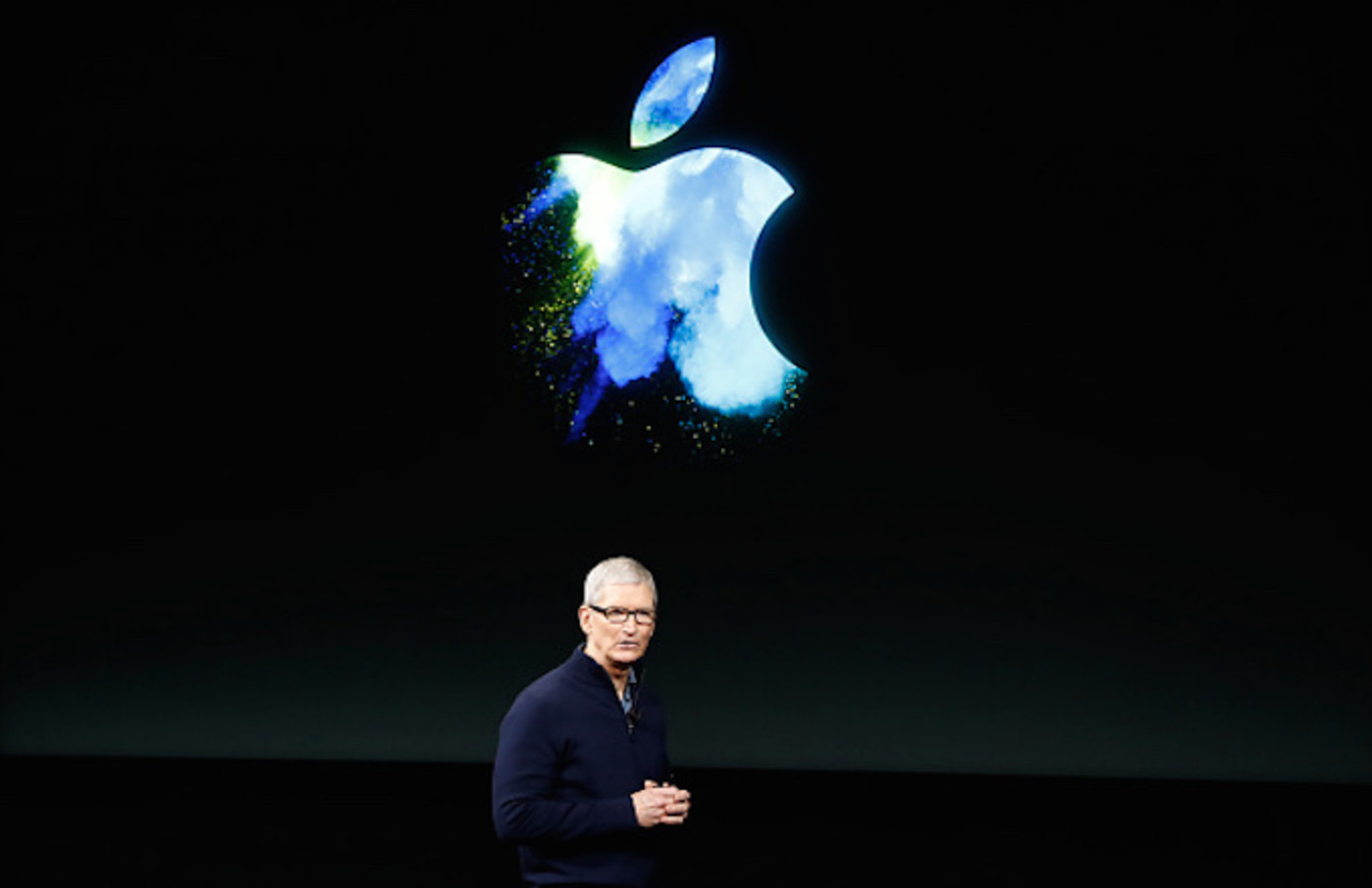 Tim Cook speaks on stage during an Apple product launch event