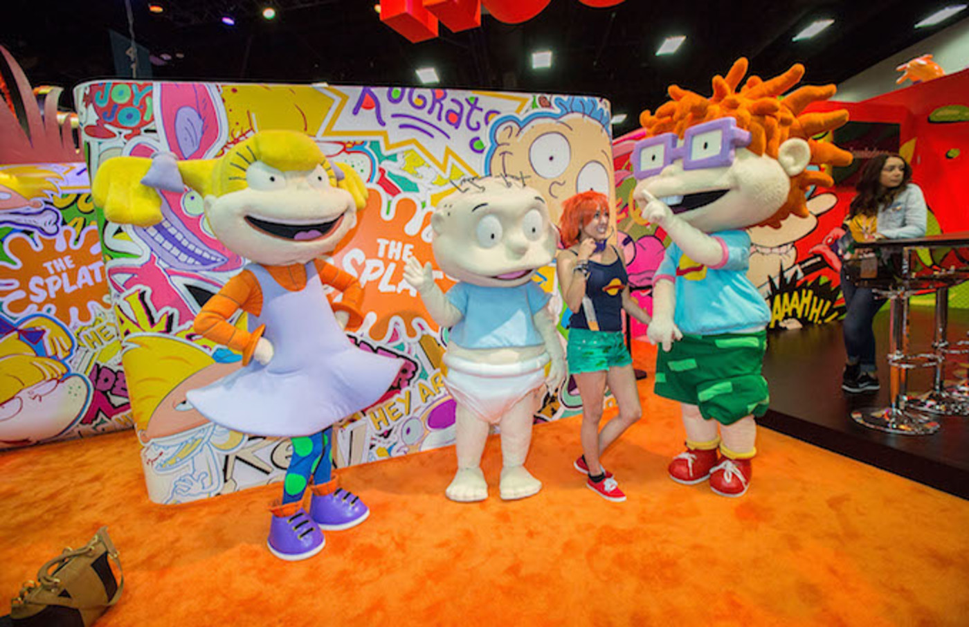 Fans pose for photos with characters from Nickelodeon's 'Rugrats' cartoon.