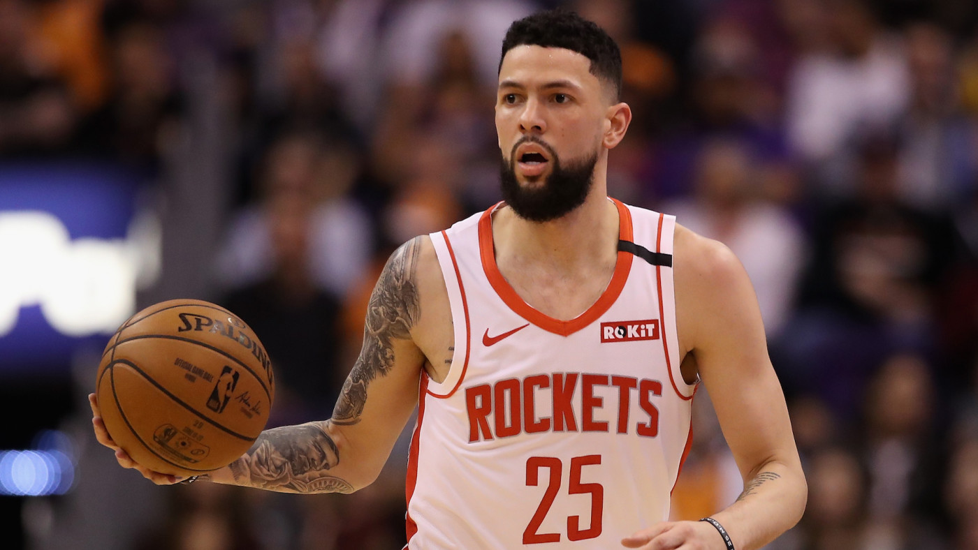Austin Rivers of the Houston Rockets handles the ball against the Phoenix Suns.