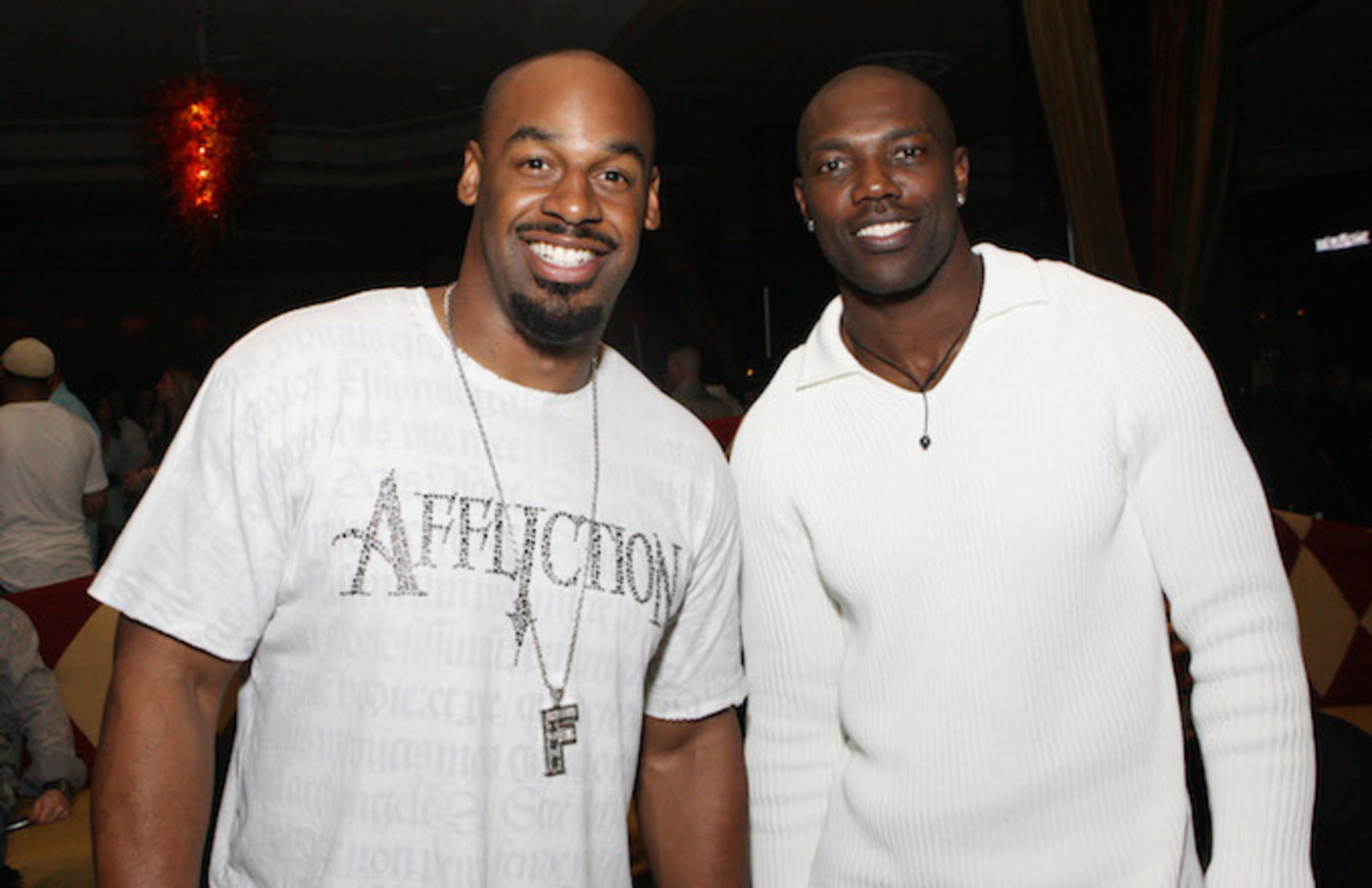 Donavan McNabb and Terrell Owens attend the Moves Magazine Annual Super Bowl Gala.