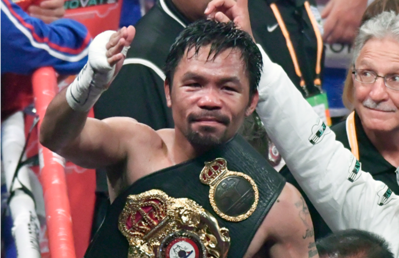 Manny Pacquiao waves to his fans after going 12 rounds