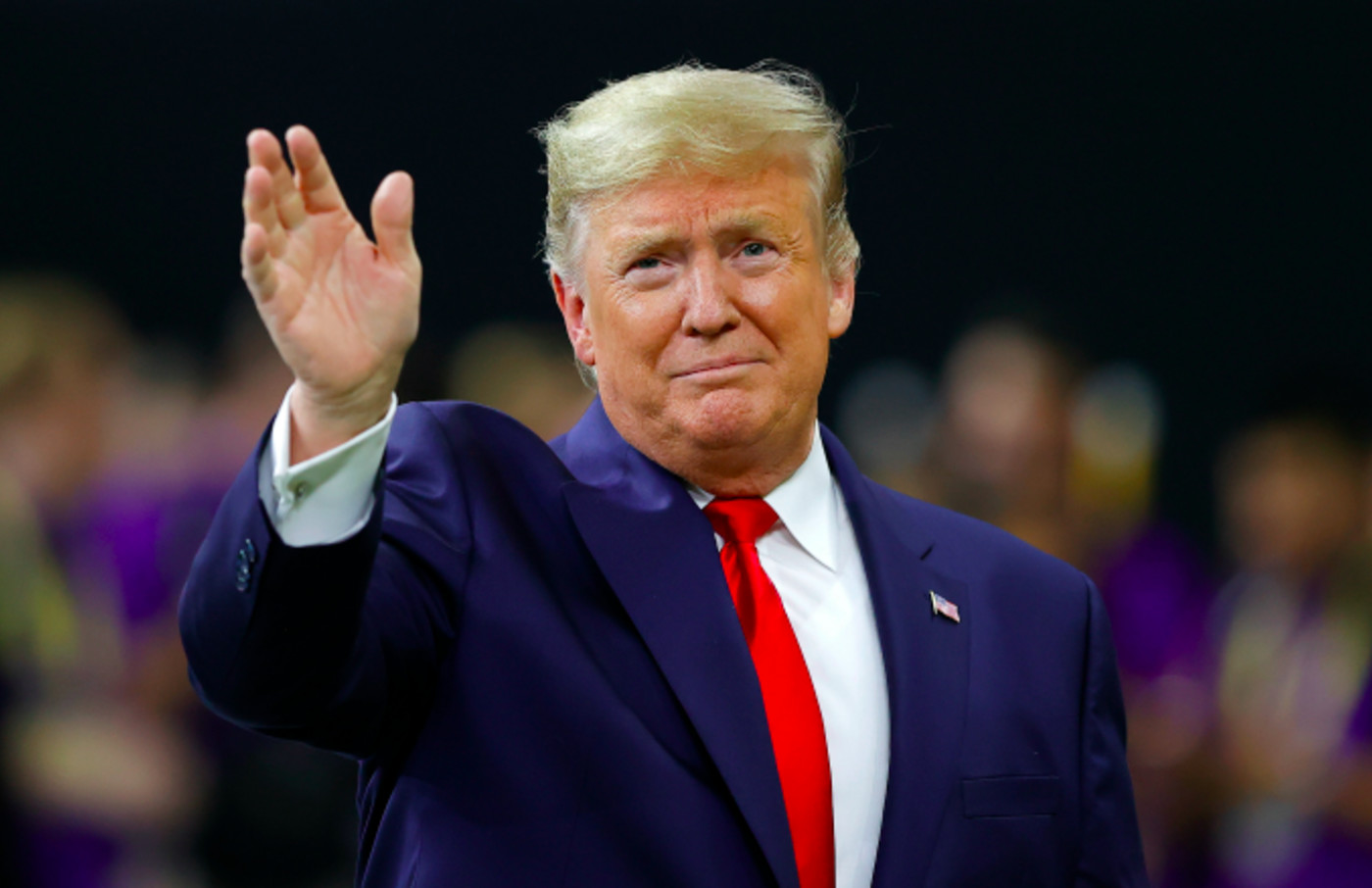 U.S. President Donald Trump waves prior to the College Football Playoff National Championship