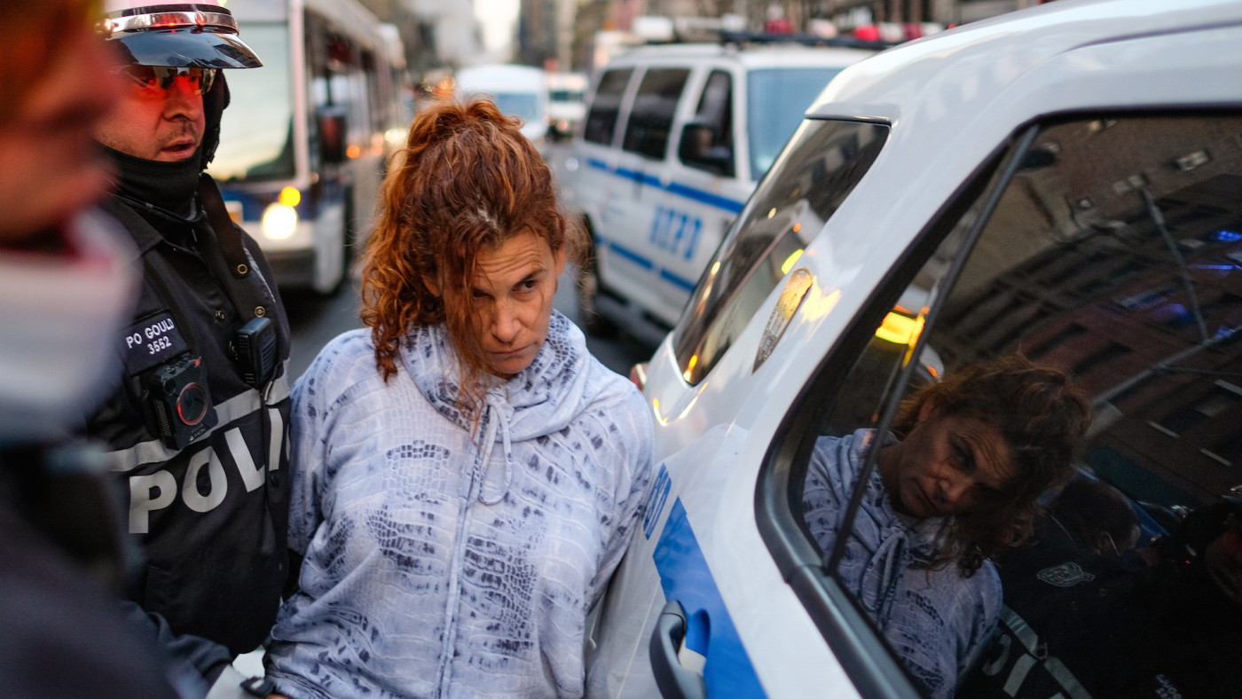 A woman is arrested by the NYPD during a ICE protest