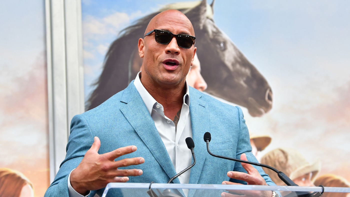 Dwayne Johnson speaks at Kevin Hart's Hand and Footprints ceremony.