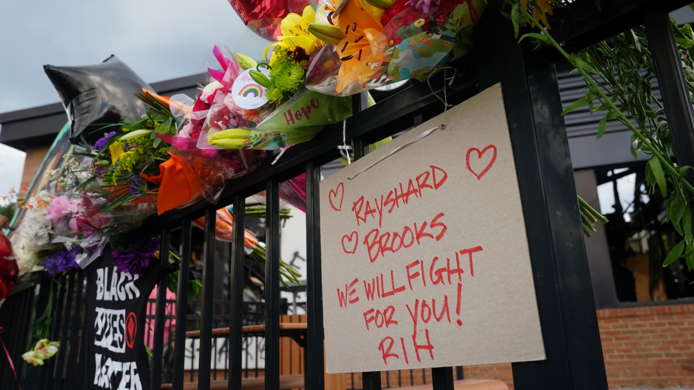 Message to Rayshard Brook is seen on a patio railing outside a burned Wendys