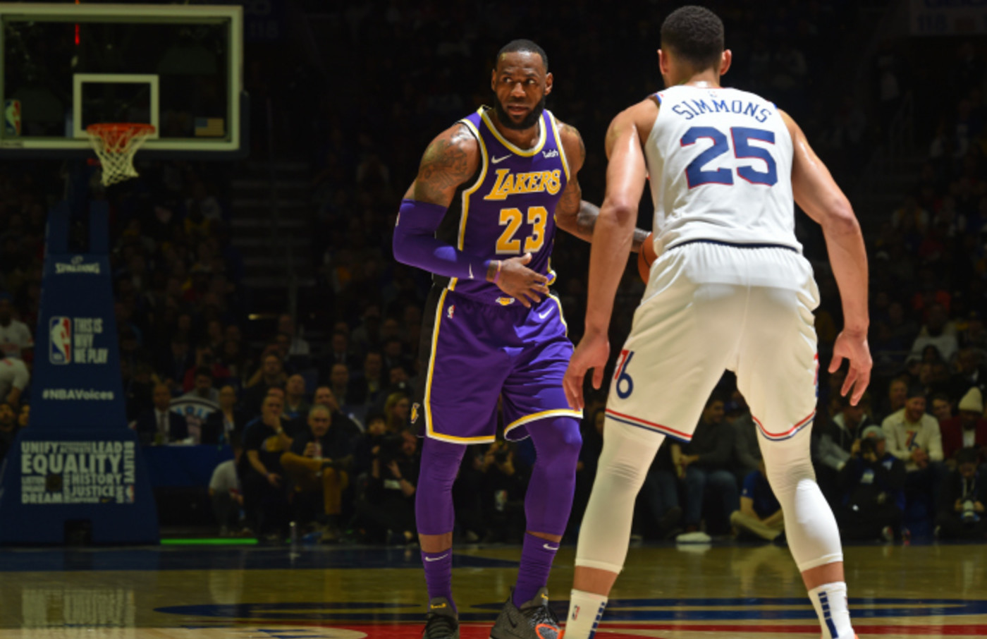 LeBron James #23 of the Los Angeles Lakers handles the ball against Ben Simmons