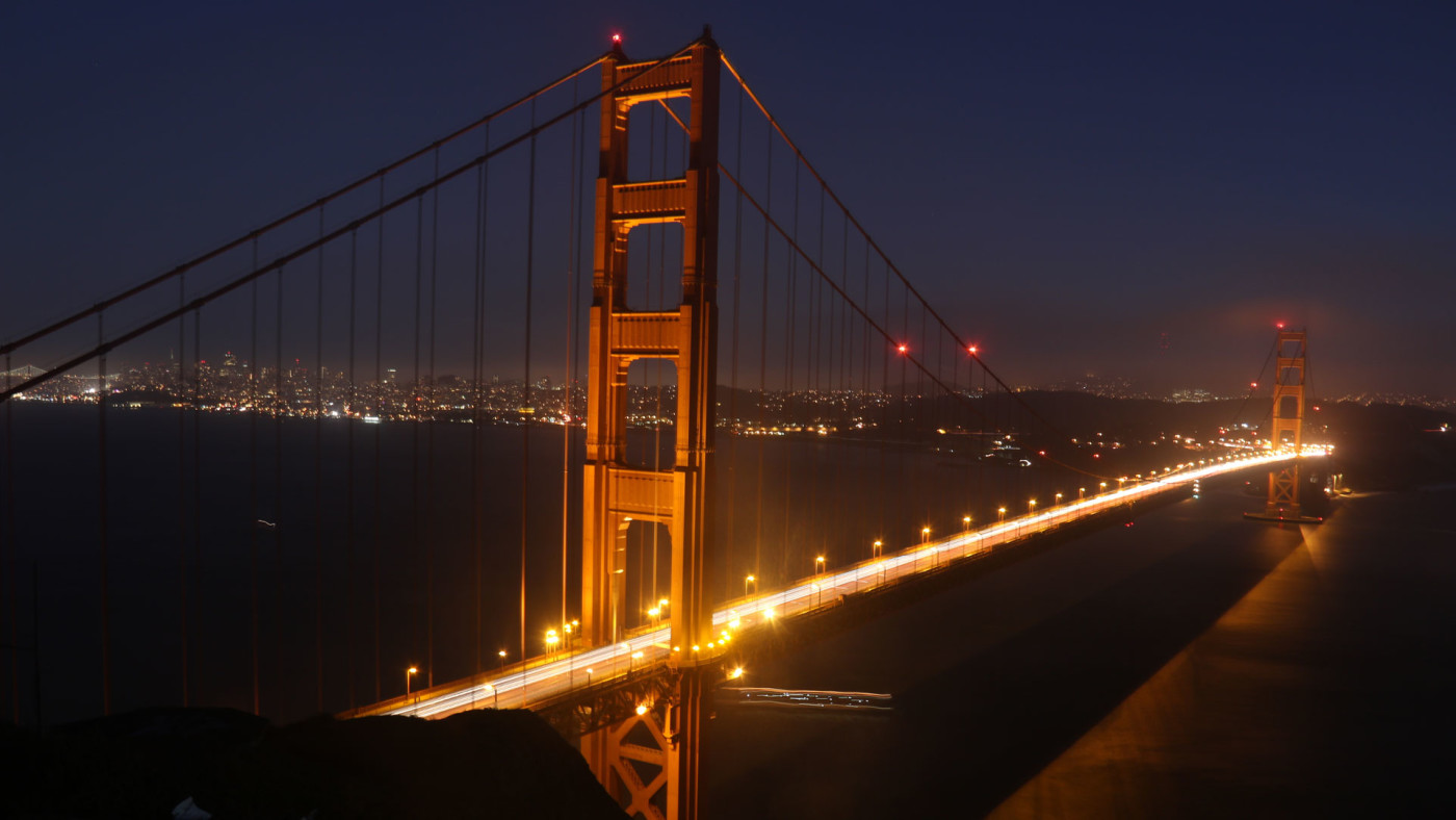 The Golden Gate Bridge at night.