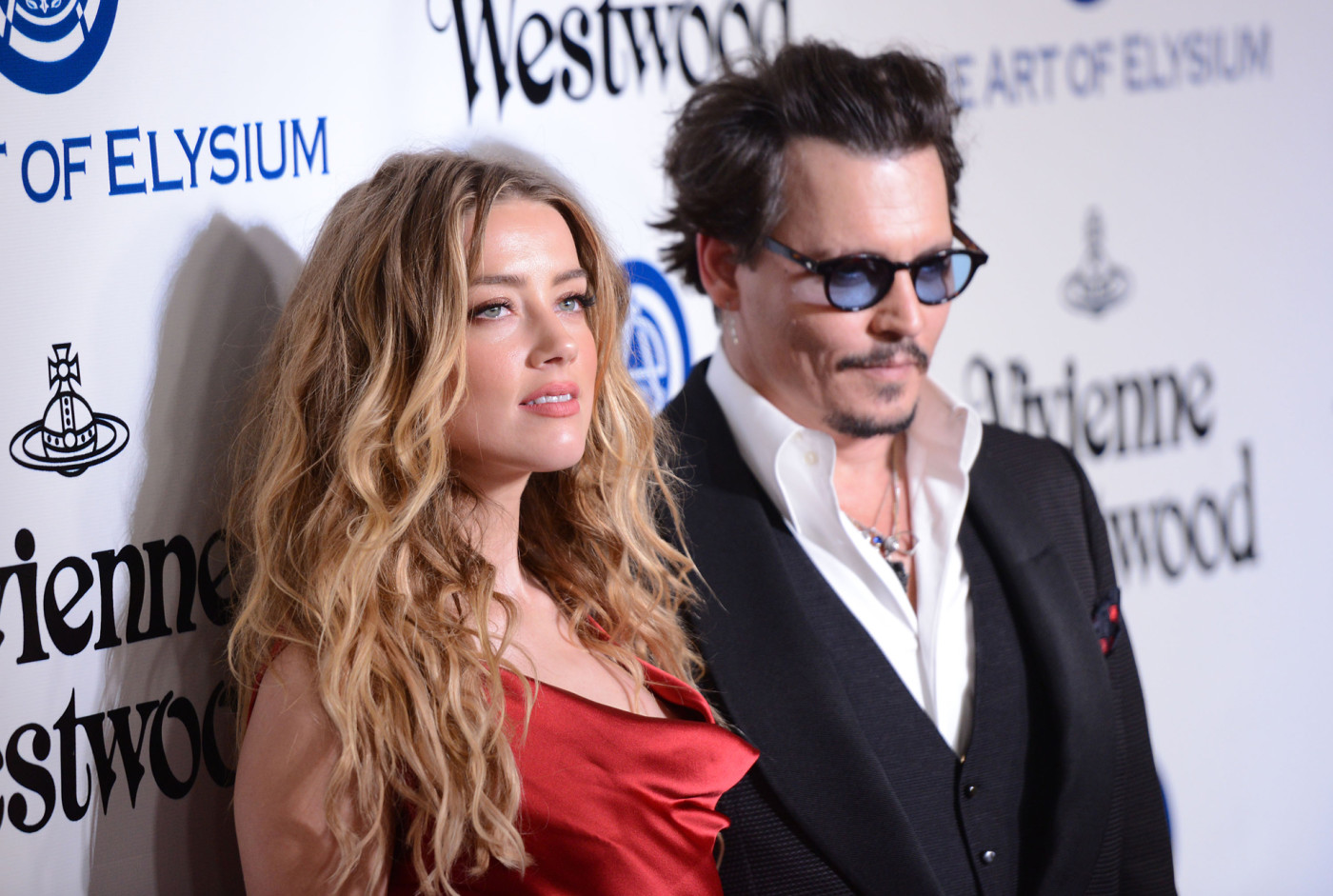 Amber Heard and Johnny Depp attend the Art of Elysium 2016 HEAVEN Gala